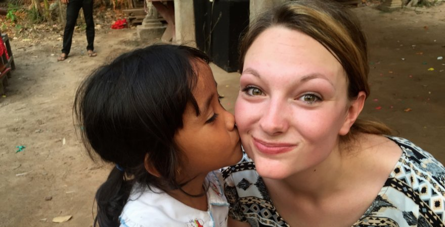 """Dr. C's daughter with Cambodian student"""