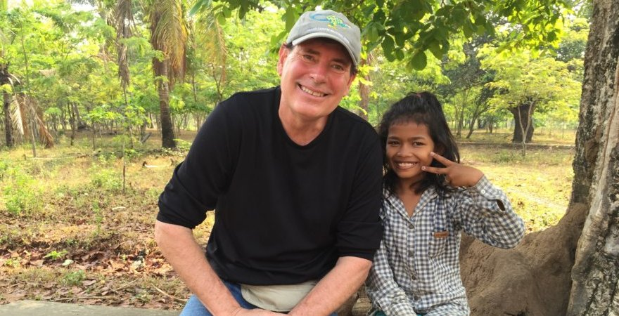 """Dr. Connell with Cambodian student"""